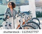 afro american woman taking a... | Shutterstock . vector #1125427757