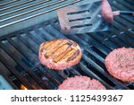 hamburger on grill grilling... | Shutterstock . vector #1125439367