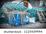 fiahing nets on the quayside   Shutterstock . vector #1125439994