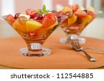 Fruit Salad - A colourful variety of fruit in glass bowls. Refreshing light meal! - stock photo