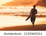 silhouette of surfer walking at ...   Shutterstock . vector #1125465311