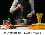 the chef prepares spaghetti and ... | Shutterstock . vector #1125474311