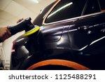 polished black car polishing... | Shutterstock . vector #1125488291
