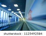 moving sidewalk. blurred photo...   Shutterstock . vector #1125492584