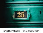 old rusty cyan postal box... | Shutterstock . vector #1125509234