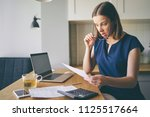 stressed over bills. portrait... | Shutterstock . vector #1125517664