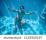 young man under the water of a... | Shutterstock . vector #1125525137