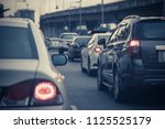 traffic jam with row of cars on ... | Shutterstock . vector #1125525179