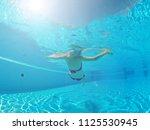 young woman enjoying in the... | Shutterstock . vector #1125530945