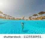 young woman enjoying in the... | Shutterstock . vector #1125530951
