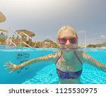 young woman enjoying in the... | Shutterstock . vector #1125530975