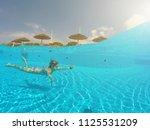 young woman enjoying in the... | Shutterstock . vector #1125531209