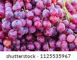 fresh red grape fruit in the...   Shutterstock . vector #1125535967