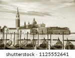 gondola floating in grand canal ... | Shutterstock . vector #1125552641