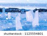 texture of ice in winter.... | Shutterstock . vector #1125554801
