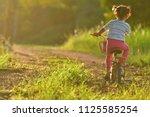 Little Girl Riding Bike In...
