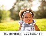 happy african american little... | Shutterstock . vector #1125601454