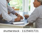 doctor and surgeon discussing... | Shutterstock . vector #1125601721
