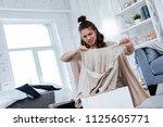 treason of husband. dark haired ... | Shutterstock . vector #1125605771