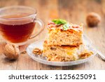 two pieces of homemade apple... | Shutterstock . vector #1125625091