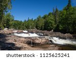 waterfalls on sand river in... | Shutterstock . vector #1125625241