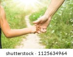 the parent holding the child's... | Shutterstock . vector #1125634964