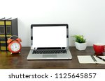 table work at home with her... | Shutterstock . vector #1125645857