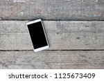 mobile phone with blank screen... | Shutterstock . vector #1125673409