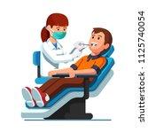 dentist woman holding... | Shutterstock .eps vector #1125740054
