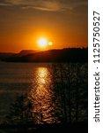 sunset at norwegian fjord in... | Shutterstock . vector #1125750527