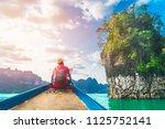 man traveler sit on boat joy... | Shutterstock . vector #1125752141