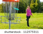 woman throwing a disc to the... | Shutterstock . vector #112575311