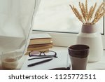 a stack of books  cup of coffee ... | Shutterstock . vector #1125772511
