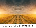 road through spring landscape... | Shutterstock . vector #1125779117
