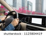hands on wheel driving car in... | Shutterstock . vector #1125804419