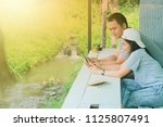 two happy frends sitting in a... | Shutterstock . vector #1125807491