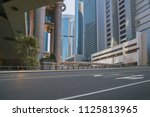 empty asphalt road and modern... | Shutterstock . vector #1125813965