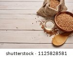 wheat grains on a light... | Shutterstock . vector #1125828581