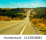 asphalted road in a dry... | Shutterstock . vector #1125828881