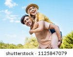 low angle view of happy couple... | Shutterstock . vector #1125847079