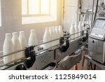 conveyor belt with white milk... | Shutterstock . vector #1125849014