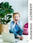 excited child with open mouth... | Shutterstock . vector #1125858359