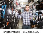 adult american  man points his... | Shutterstock . vector #1125866627