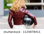 back view of woman in leather... | Shutterstock . vector #1125878411