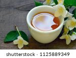 jasmine tea in a white cup with ... | Shutterstock . vector #1125889349