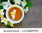 jasmine tea in a white cup with ... | Shutterstock . vector #1125889595