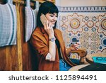 cheerful hipster girl checking... | Shutterstock . vector #1125894491
