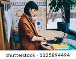 thoughtful hipster girl... | Shutterstock . vector #1125894494