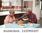 senior couple enjoying meal... | Shutterstock . vector #1125903107
