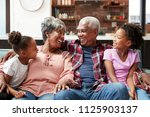 grandparents relaxing on sofa... | Shutterstock . vector #1125903137